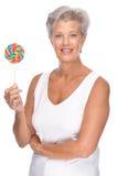 Femme aîné avec des bonbons Photographie stock