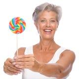 Femme aîné avec des bonbons Photo libre de droits