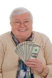 Femme aîné avec des dollars - format vertical Image libre de droits
