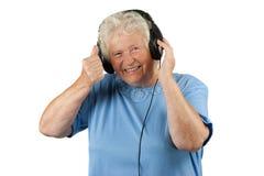 Femme aîné avec des eraphones Image stock