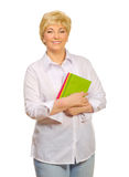 Femme aîné avec des livres Photos stock