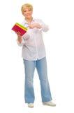 Femme aîné avec des livres Photos libres de droits