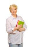 Femme aîné avec des livres Images stock