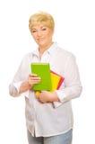 Femme aîné avec des livres Photo libre de droits