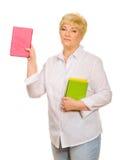 Femme aîné avec des livres Photo stock