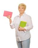 Femme aîné avec des livres Photographie stock