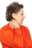 Femme aîné avec douleur cervicale Photos stock
