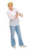 Femme aîné avec l'horloge Image stock