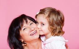 Femme aîné avec la petite-fille Image stock