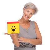 Femme aîné avec le cadre Images stock