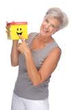 Femme aîné avec le cadre Image libre de droits