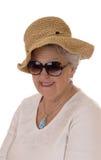 Femme aîné avec le chapeau de paille Photo libre de droits