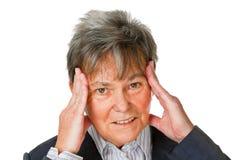 Femme aîné avec le mal de tête Photo libre de droits
