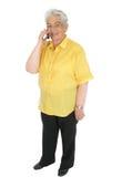 Femme aîné avec le téléphone portable Photographie stock