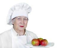 Femme aîné dans le chapeau de chef Image libre de droits