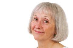 Femme aîné de sourire avec l'expression douce image stock