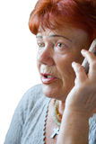 Femme aîné effrayé avec le portable Image libre de droits