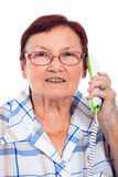 Femme aîné heureux au téléphone Photographie stock libre de droits