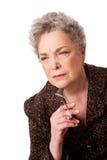 Femme aîné pensant au contrat à terme Images libres de droits