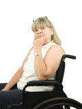 Femme aîné pensant dans la présidence de roue Photographie stock libre de droits