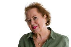 Femme aîné sur le fond blanc Photographie stock