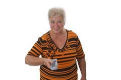 Femme aîné zapping avec à télécommande Images stock