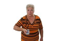 Femme aîné zapping avec à télécommande Photo libre de droits