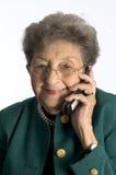 Femme aînée au téléphone Images libres de droits