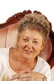 Femme aînée dans le fauteuil. Photos stock