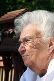 Femme aînée de rêverie Photo stock