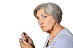 Femme aînée malade Photos stock