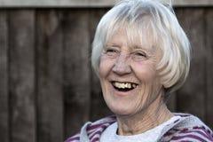 Femme aînée riante Image libre de droits