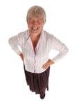 Femme aînée riante d'affaires sur le blanc Photographie stock libre de droits
