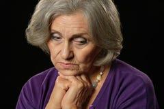 Femme aînée triste Photo stock