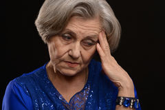 Femme aînée triste Photos stock