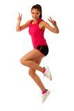 Femme active faisant l'aérobic pour une cardio- danse de formation Images stock