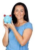 Femme adorable avec un argent-cadre bleu Photos stock