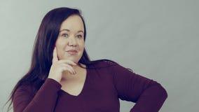 Femme adulte de pensée photographie stock libre de droits