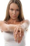 Femme affichant des mains Photographie stock