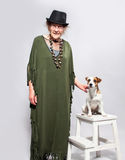 Femme agée élégante avec le chien Images stock