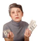 Femme agée avec des dollars Photos libres de droits
