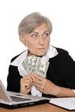 Femme agée avec des dollars Photo libre de droits