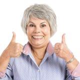 Femme agée avec des pouces  Image libre de droits