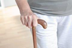 Femme agée avec le bâton de marche Images stock