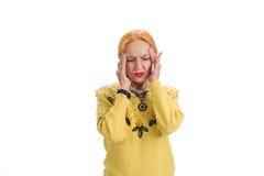 Femme agée avec le mal de tête d'isolement Photo libre de droits