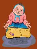 Femme agée dans un tablier bleu dans une veste rose Photo libre de droits