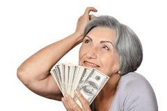 Femme agée heureuse avec des dollars Images libres de droits