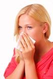 Femme allergique assez jeune Photographie stock libre de droits