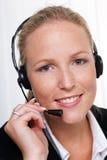 Femme amical avec un écouteur Photo stock