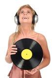 Femme appréciant la musique Image stock
